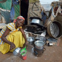 Centenary Christian Aid woman making tea.jpg