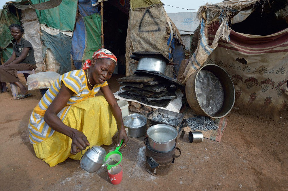 Centenary Christian Aid woman making tea.jpg