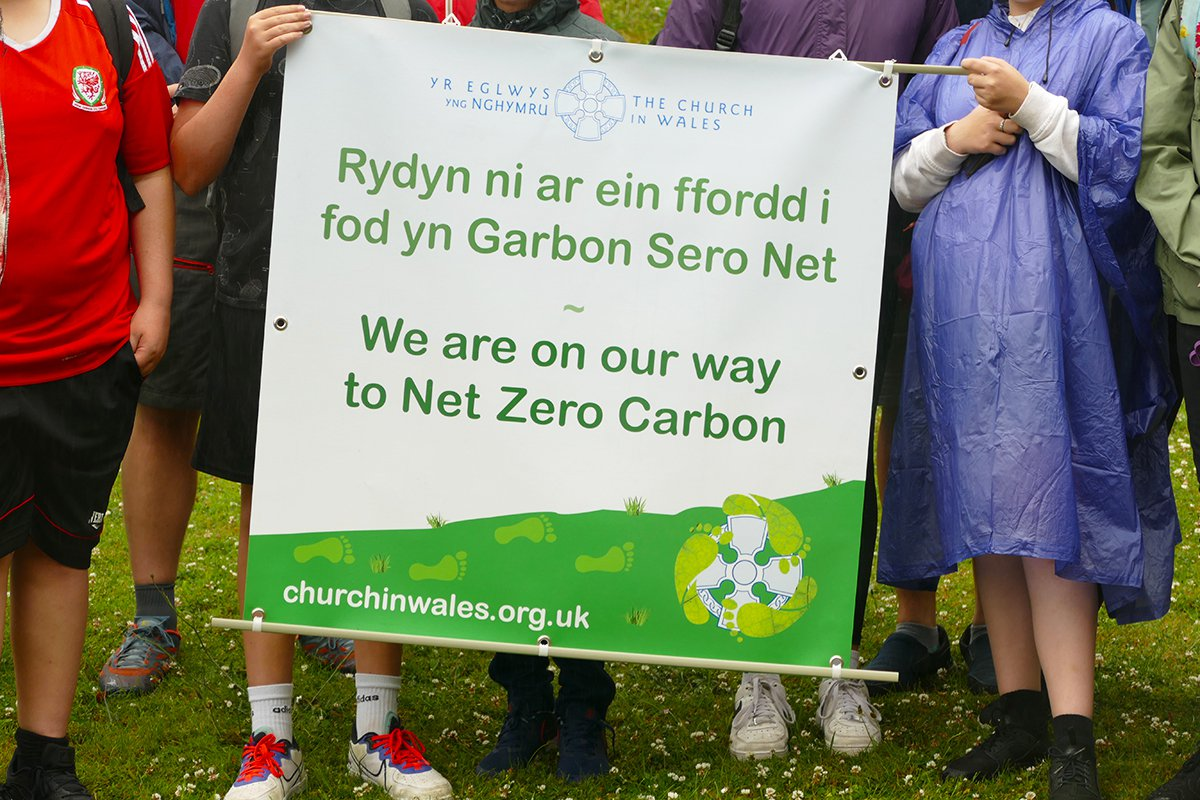 Launch of the Relay to COP26 from Swansea holding net zero carbon banner