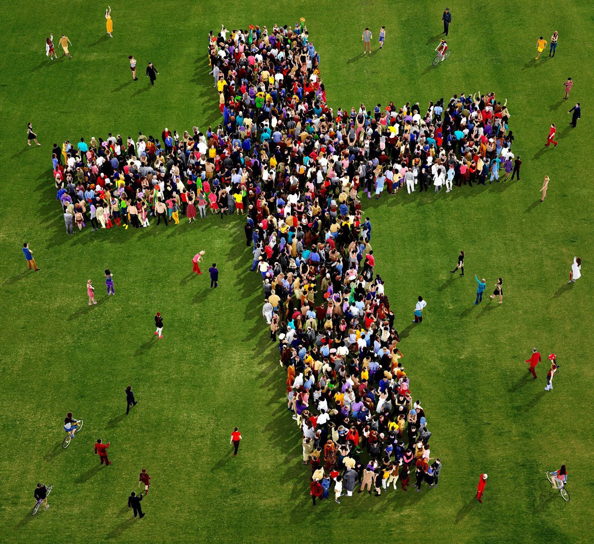 Crucifix shape comprising people on a lawn